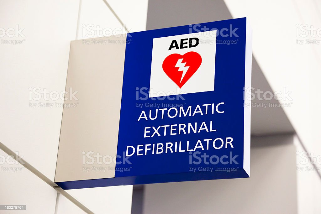 Blue automated external defibrillator sign mounted on a wall royalty-free stock photo