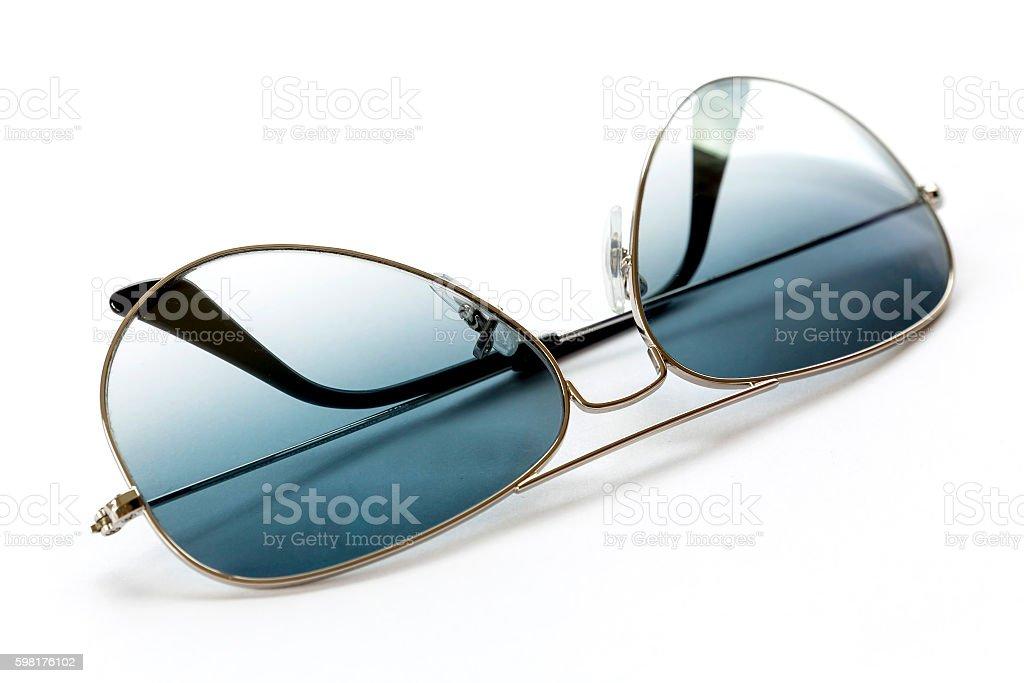 Blue aviator sunglasses on white stock photo