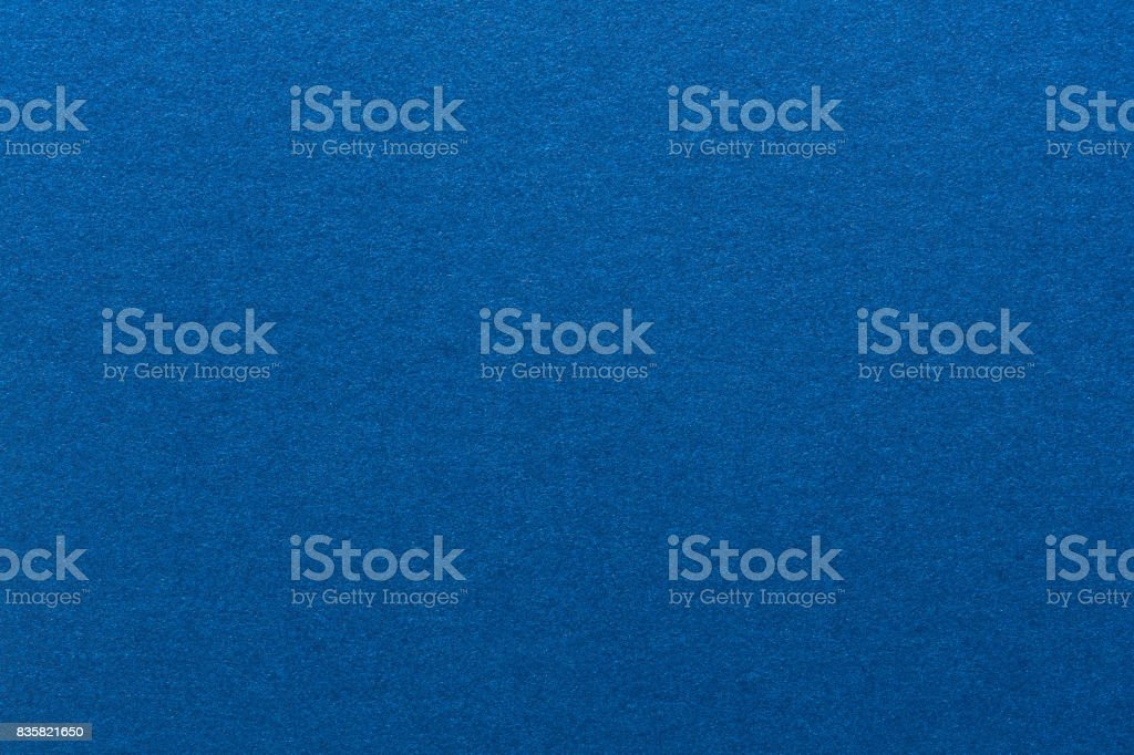 Blue background from a textile material stock photo