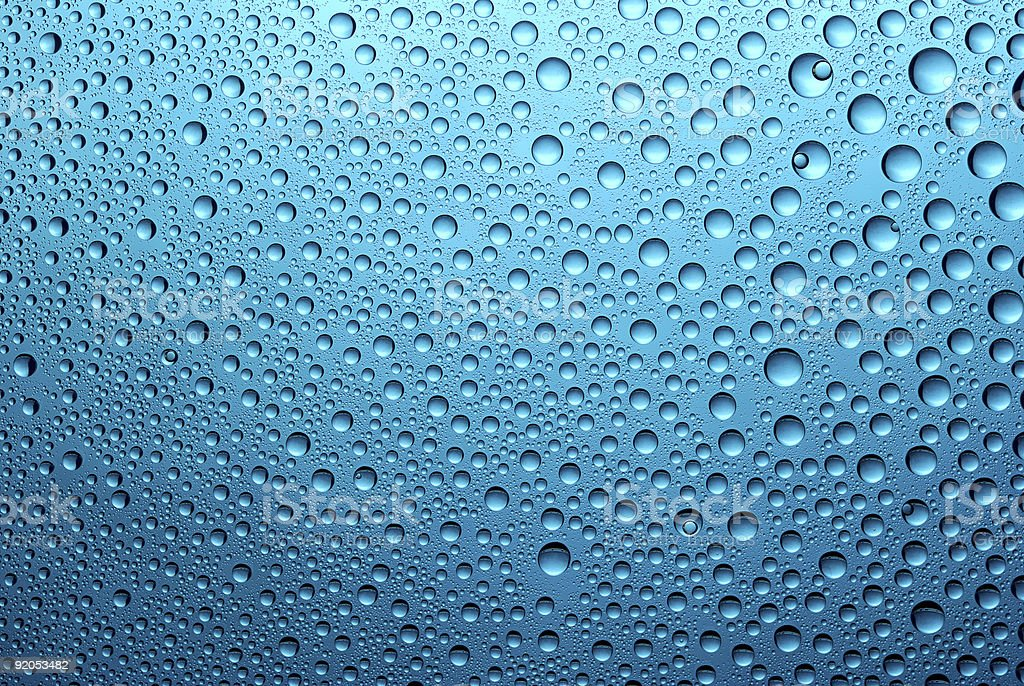 Blue background of water droplets on a glass surface royalty-free stock photo