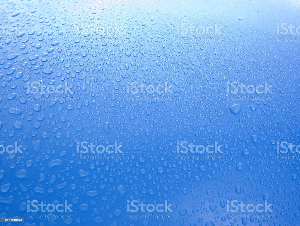 Blue background with water drops royalty-free stock photo