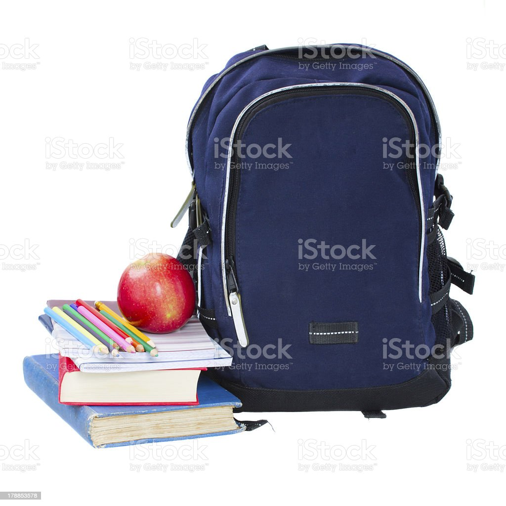 Blue backpack and stack of books royalty-free stock photo