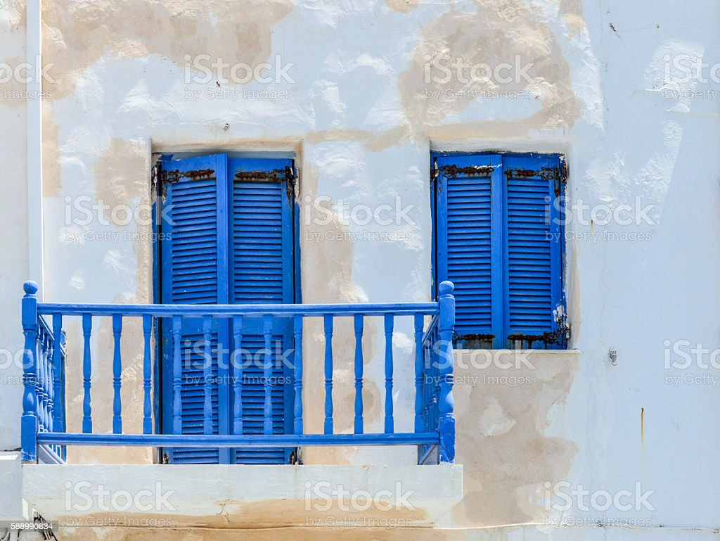 Blue balconies and windows on white buildings - Greece stock photo