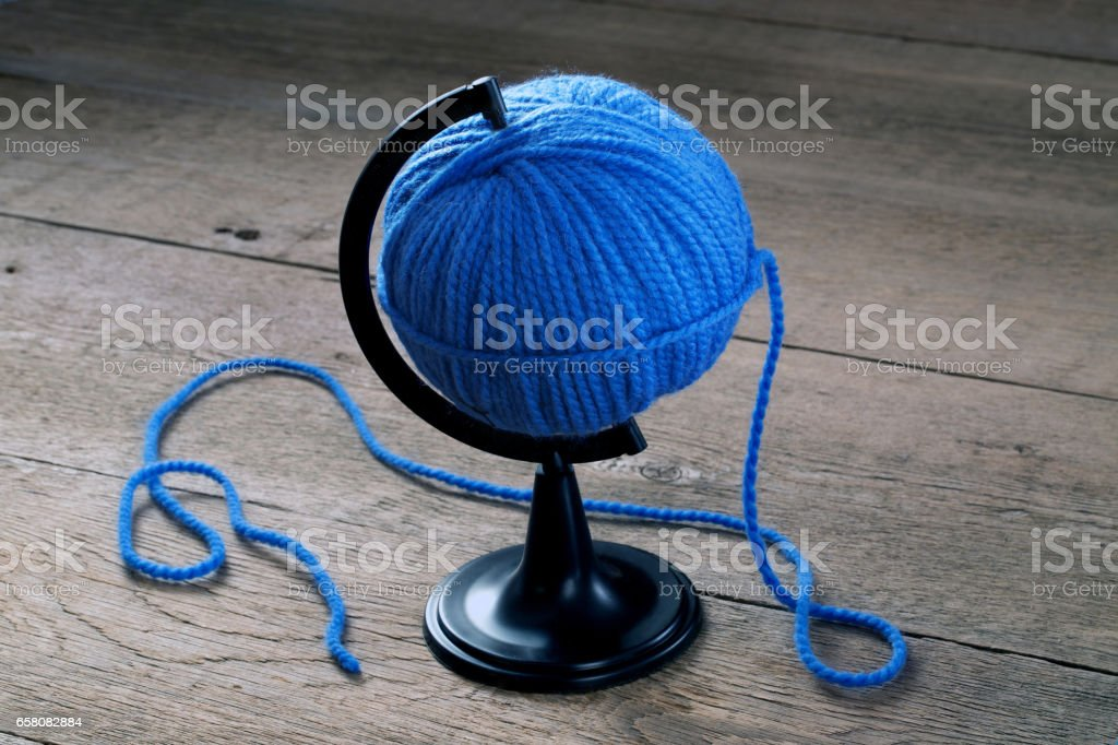 blue ball of yarn on a stand for the Globe stock photo