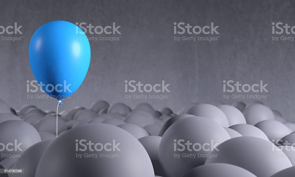Blue balloon rising from gray background: individuality, standing out stock photo