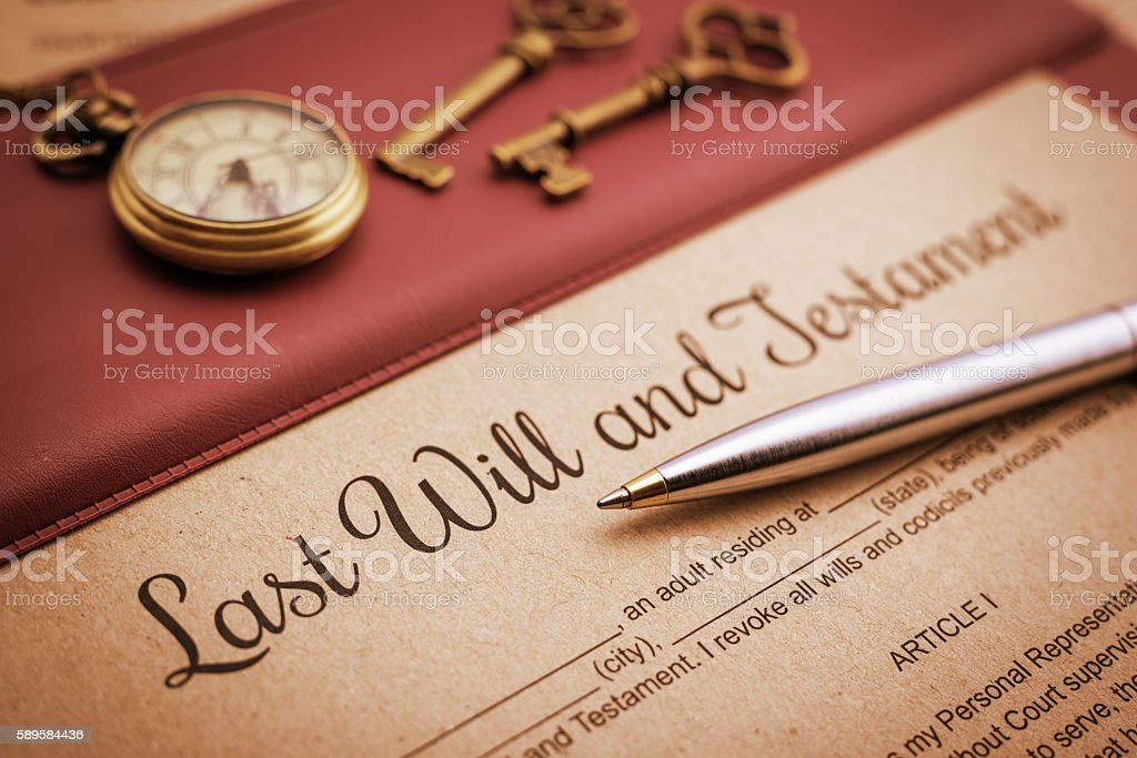 Blue ballpoint pen and a last will and testament. stock photo