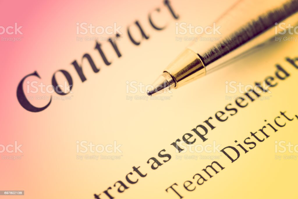 Blue ballpoint pen on a contract. stock photo