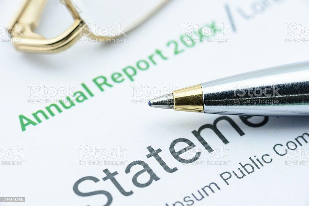 Blue ballpoint pen on an association's annual report stock photo