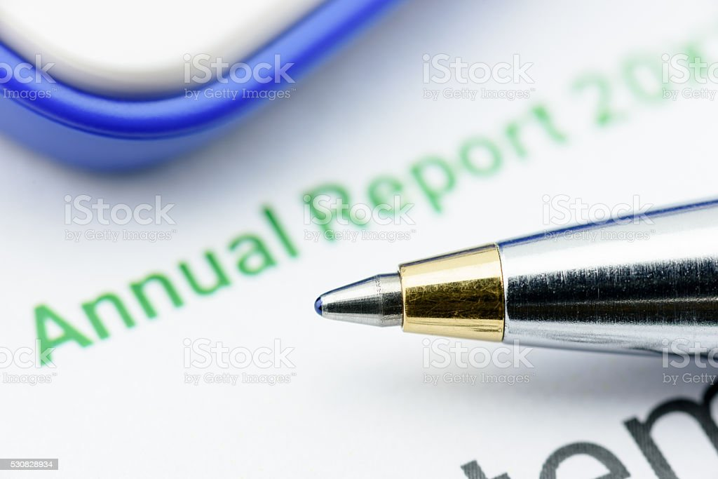 Blue ballpoint pen on an enterprise's annual report. stock photo