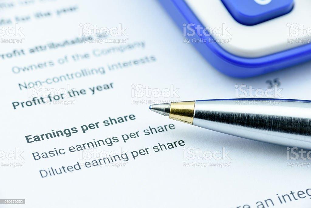 Blue ballpoint pen on an organization's income statement stock photo