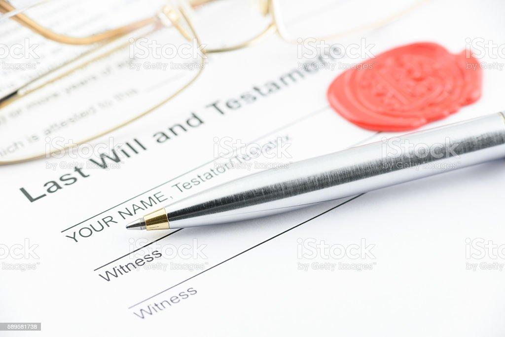 Blue ballpoint pen on last will and testament. stock photo