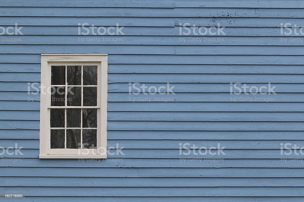 blue barn, white window stock photo
