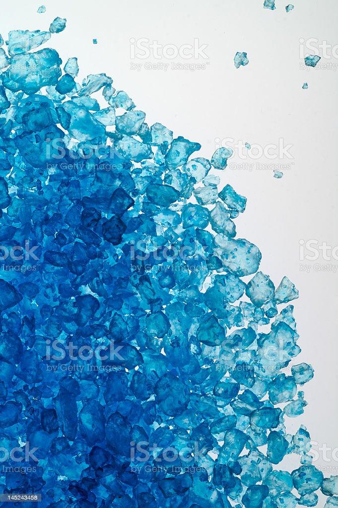 Blue bath salt on light table royalty-free stock photo