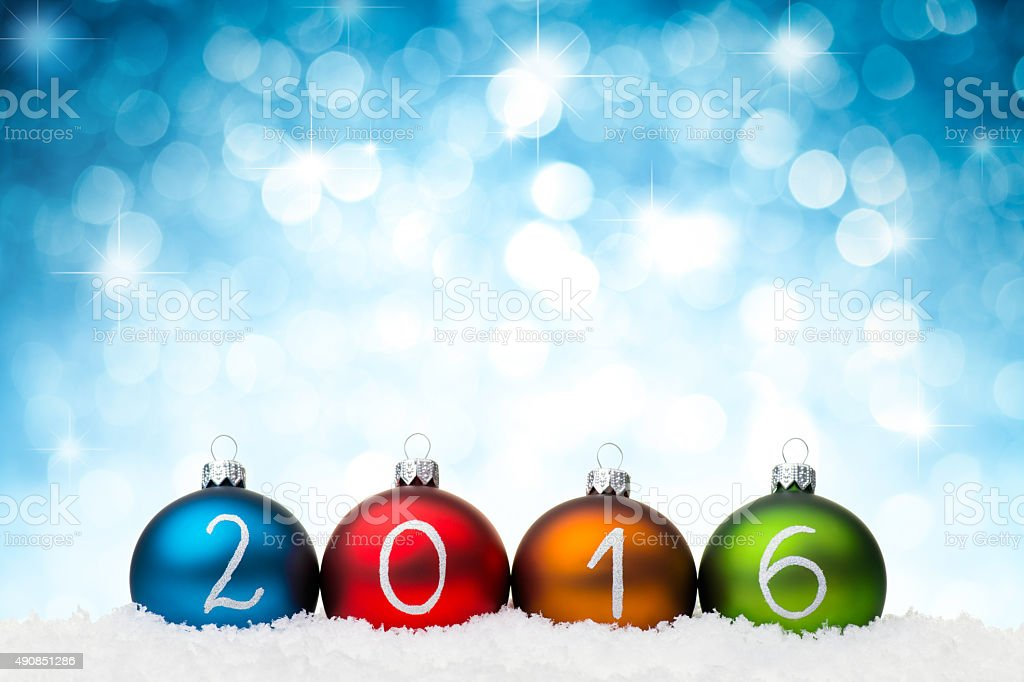 Blue baubles 2016 year, star shape glitters stock photo