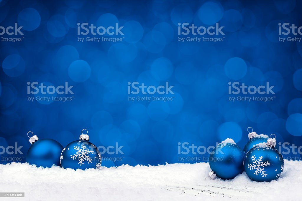 Blue baubles on sheet notes stock photo