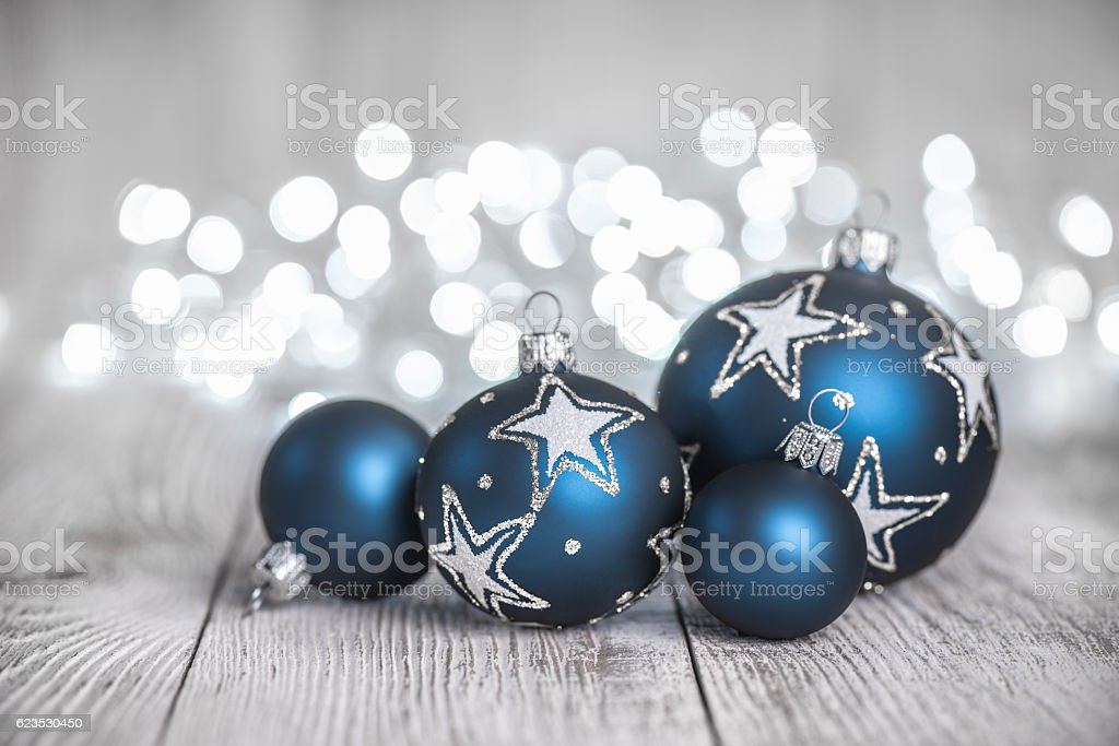 Blue Baubles with Star shape decoration on White Wood stock photo