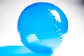 Blue Beach Ball on White Backdrop