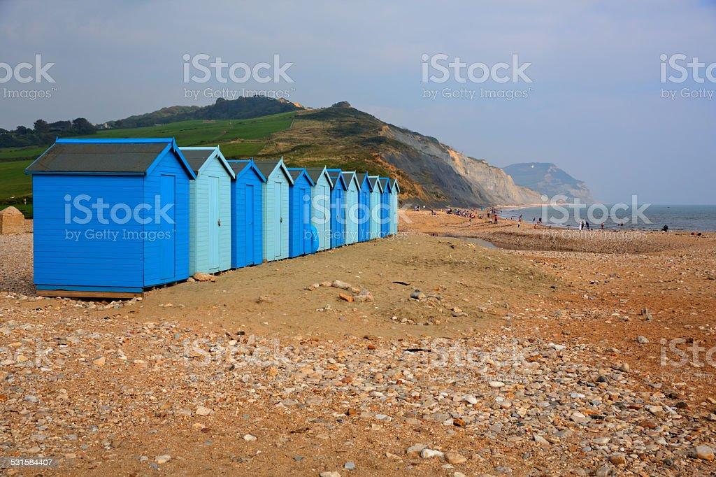 Blue beach huts Charmouth Dorset England UK stock photo