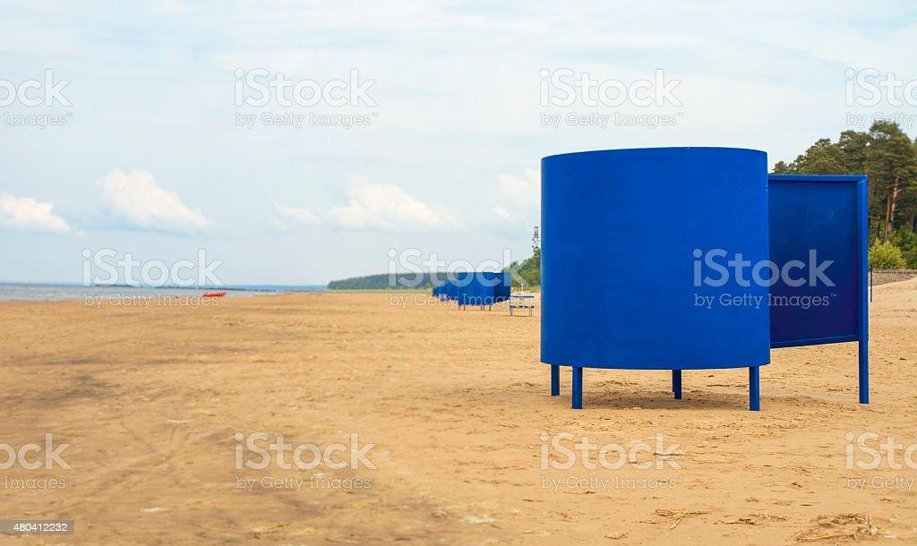 Blue beach huts on the empty beach. stock photo