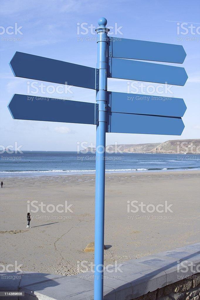 Blue Beach Signpost stock photo