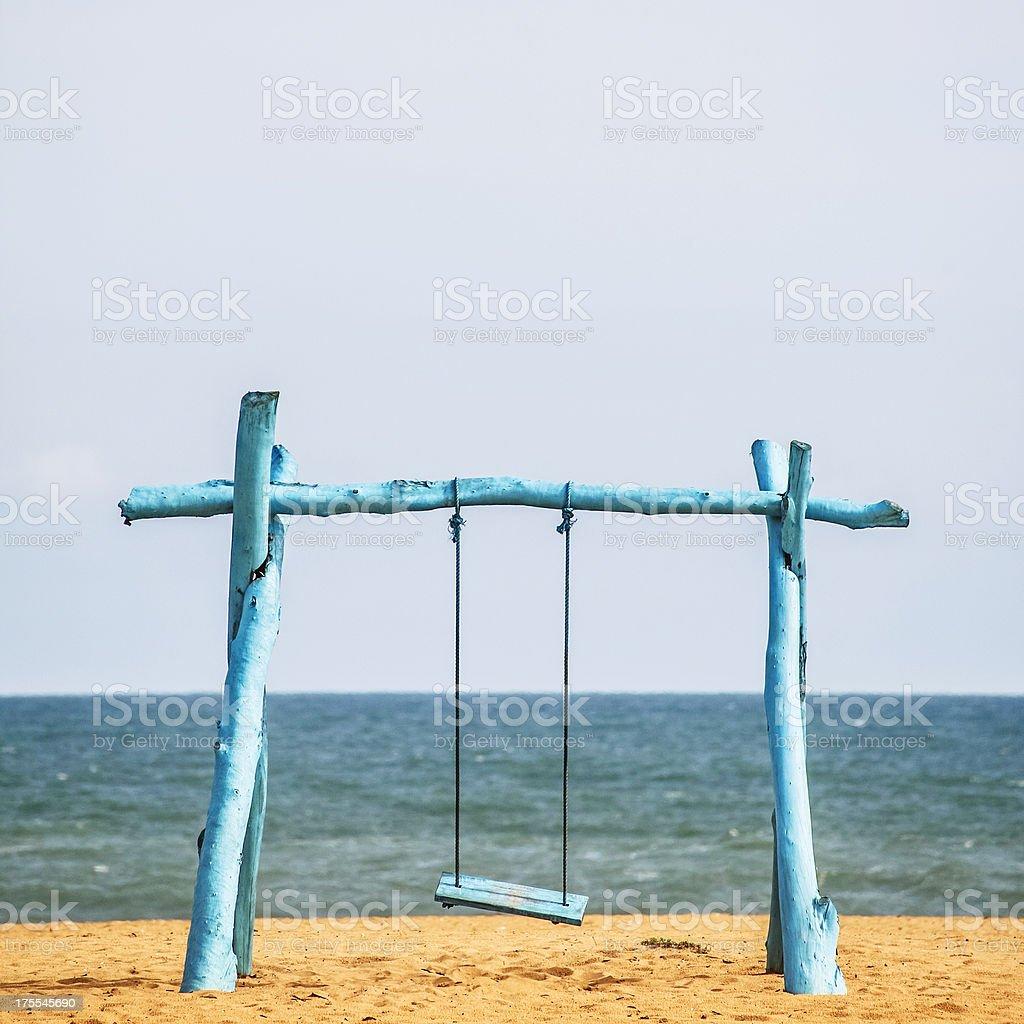 Blue beach swing. stock photo