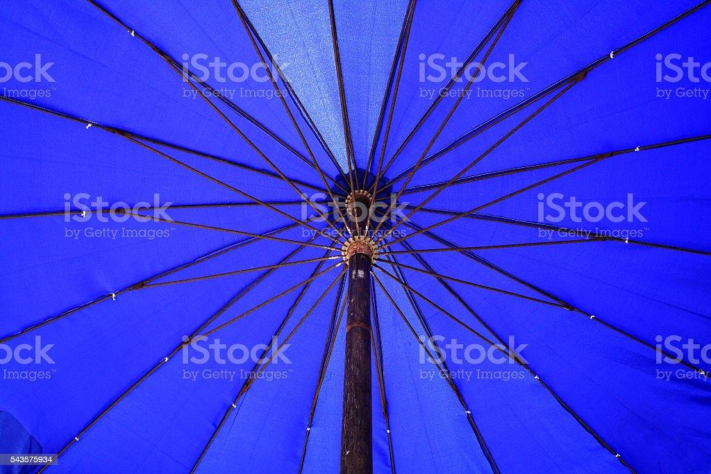 Blue beach umbrella stock photo