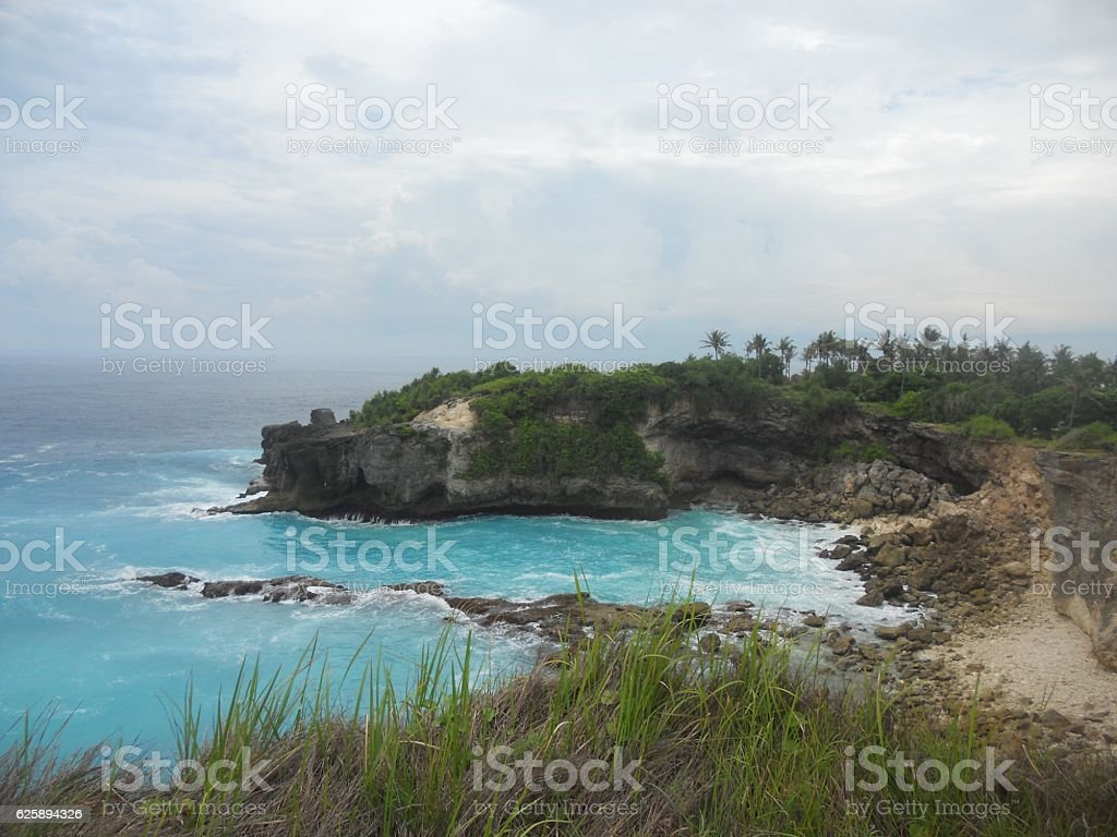 Blue beach with cliff stock photo