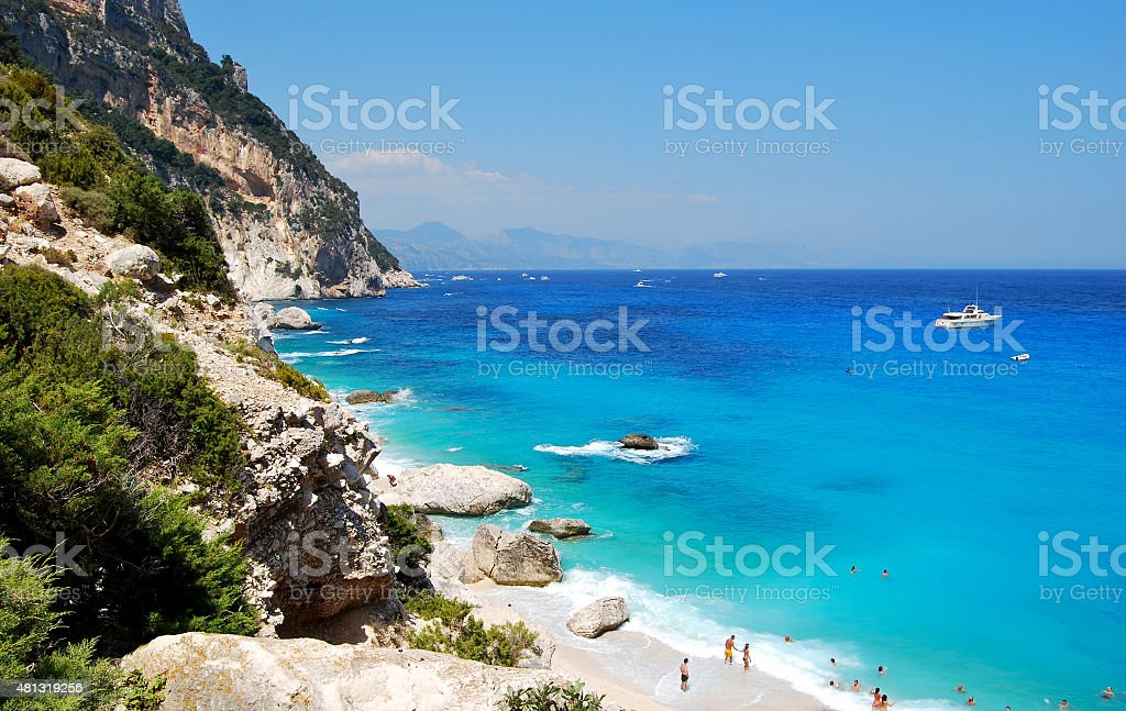 Blue beach with some people seen from top Cala Goloritze stock photo