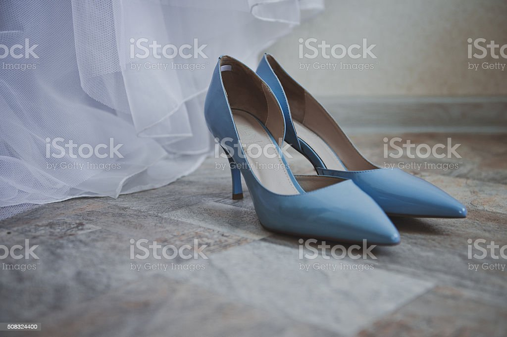 Blue beautiful shoes for the wedding stock photo