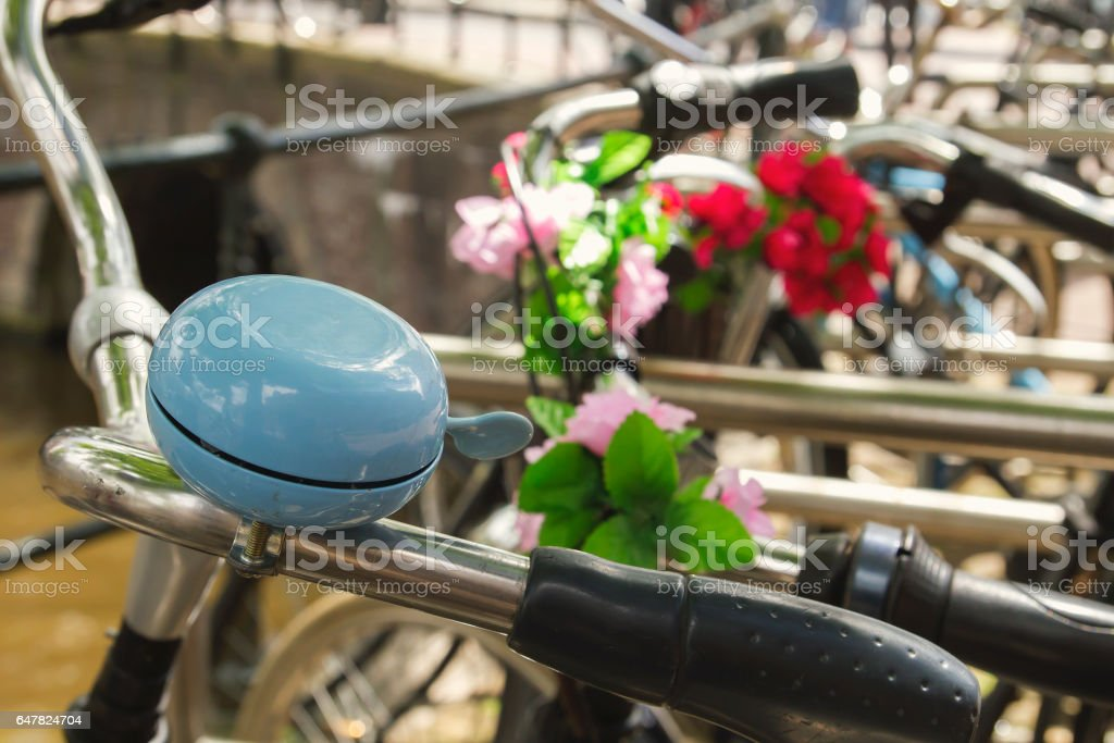 blue bell, bikes parked beside a canal in Amsterdam stock photo
