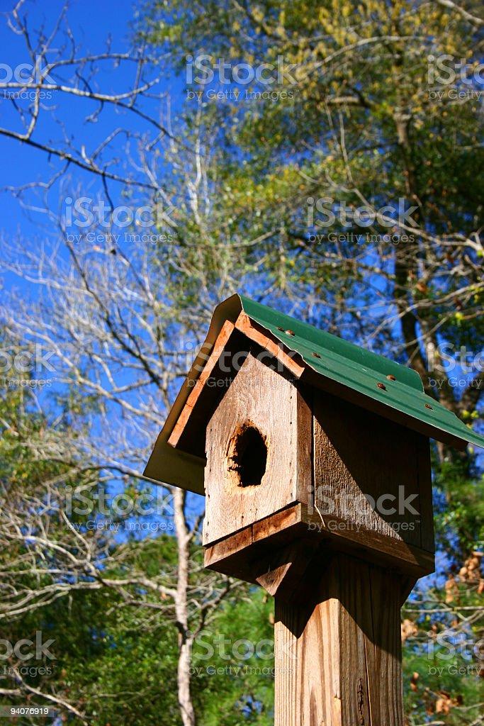 Blue bird house royalty-free stock photo