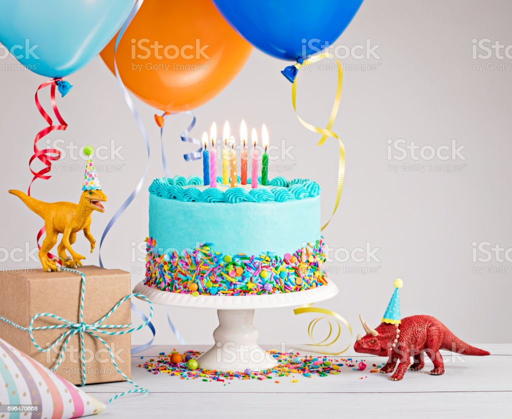 Blue Birthday Cake with Balloons stock photo