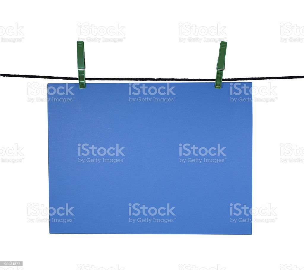 blue blank sheet on clothes-line for your notice royalty-free stock photo