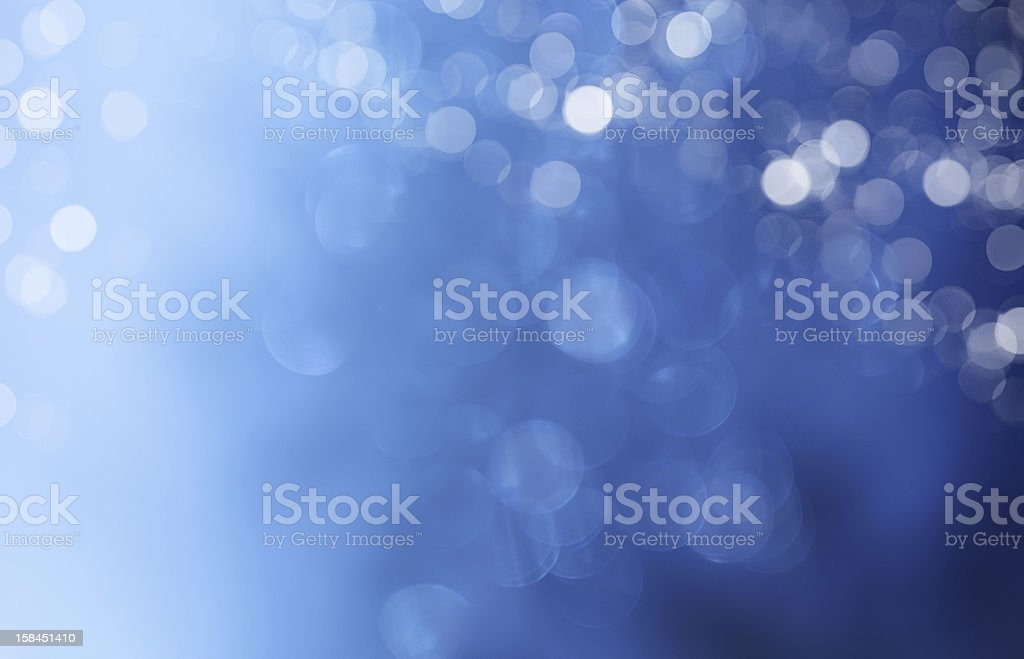 Blue blurred background of light circles stock photo