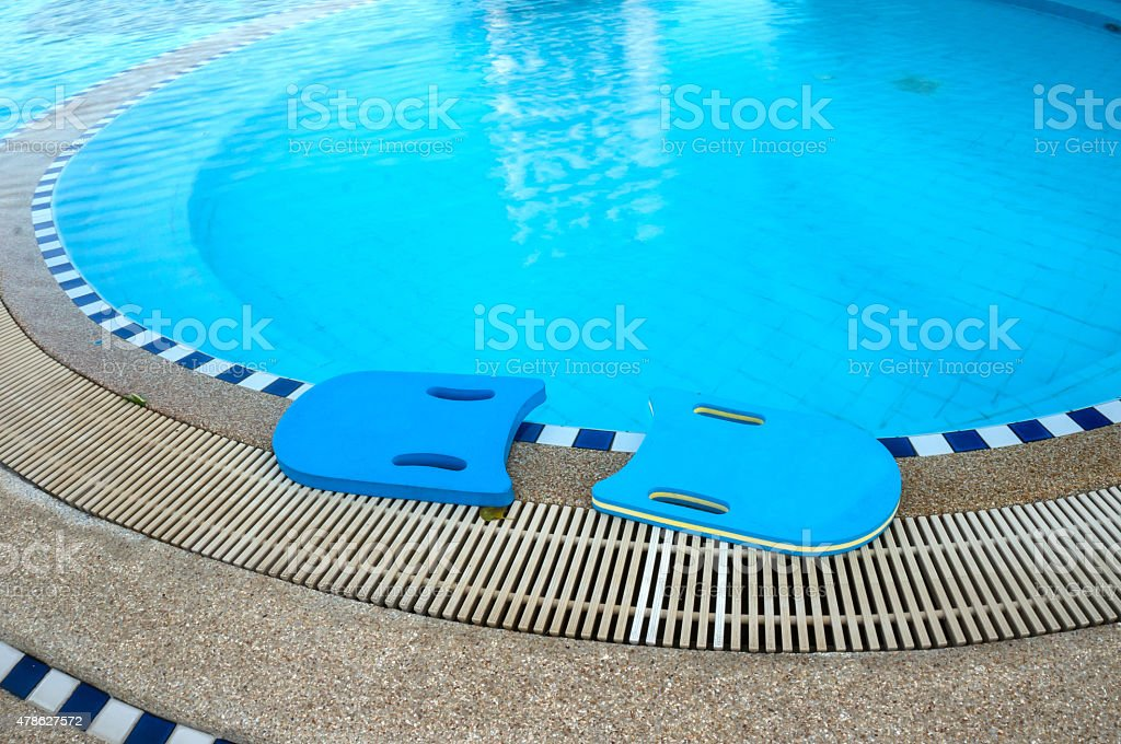 Blue boards next to swimming pool stock photo