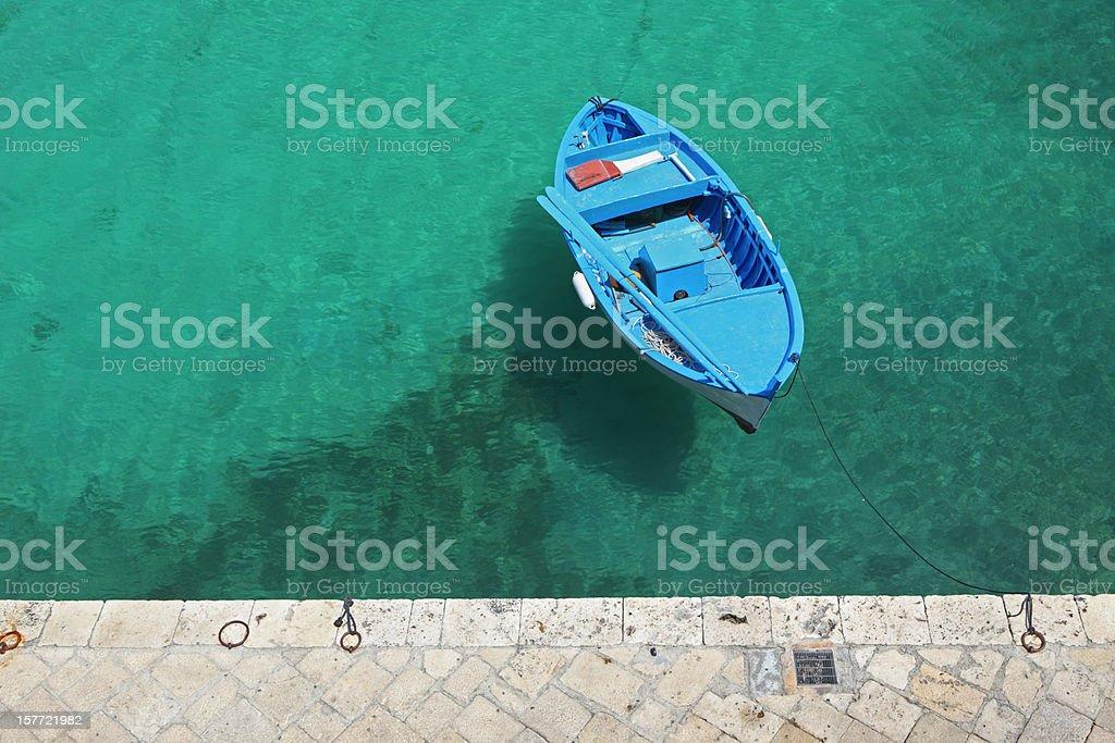Blue boat from above in Tricase Porto, Puglia Italy stock photo