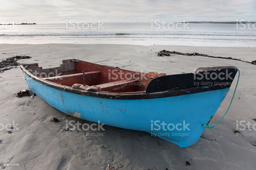 Blue boat on the Paternoster beach in South Africa 1 stock photo