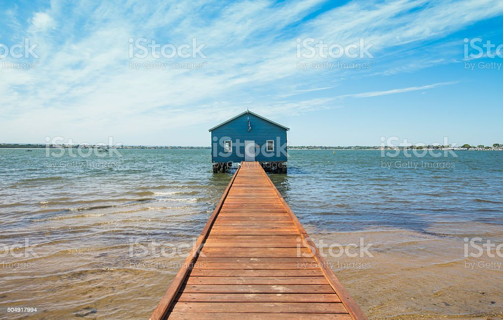 Blue Boat Shed at the Pier stock photo