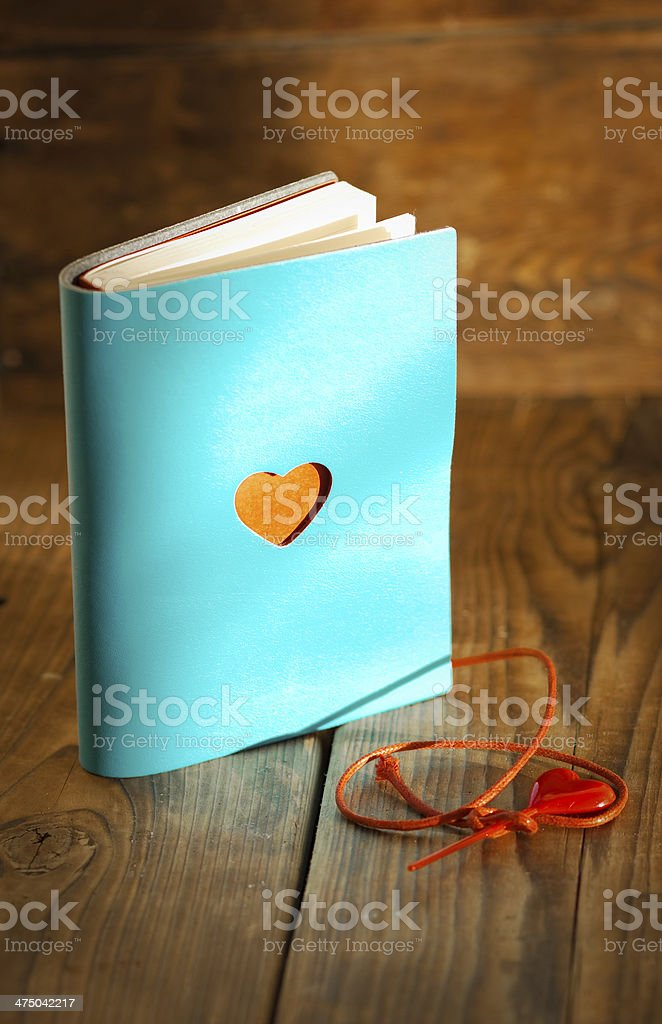 Blue book with red heart royalty-free stock photo