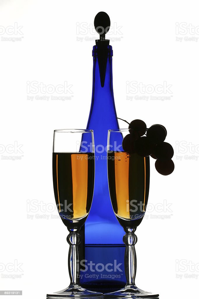 Blue bottle of wine, glasses and grapes royalty-free stock photo