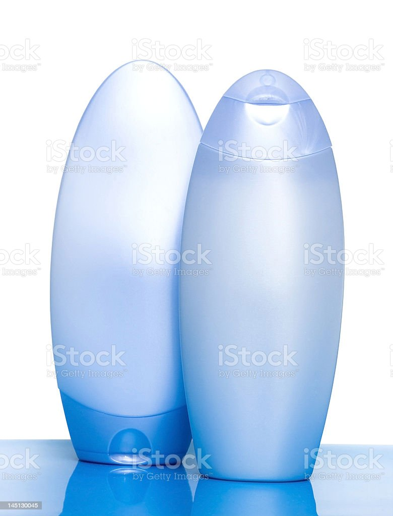 blue bottles with shampoo on white background royalty-free stock photo