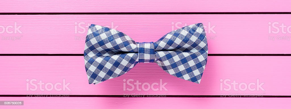 Blue bow tie on pink background stock photo