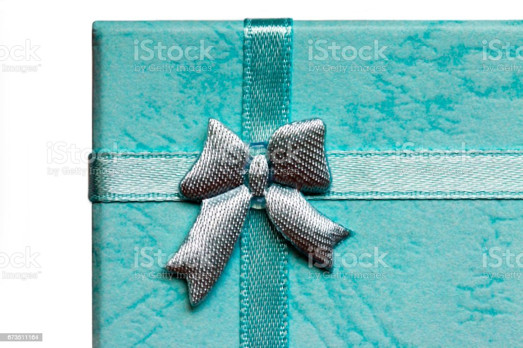 Blue box with a bow close-up stock photo