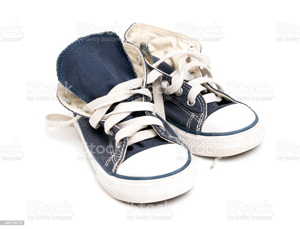 blue boy sneakers on white stock photo