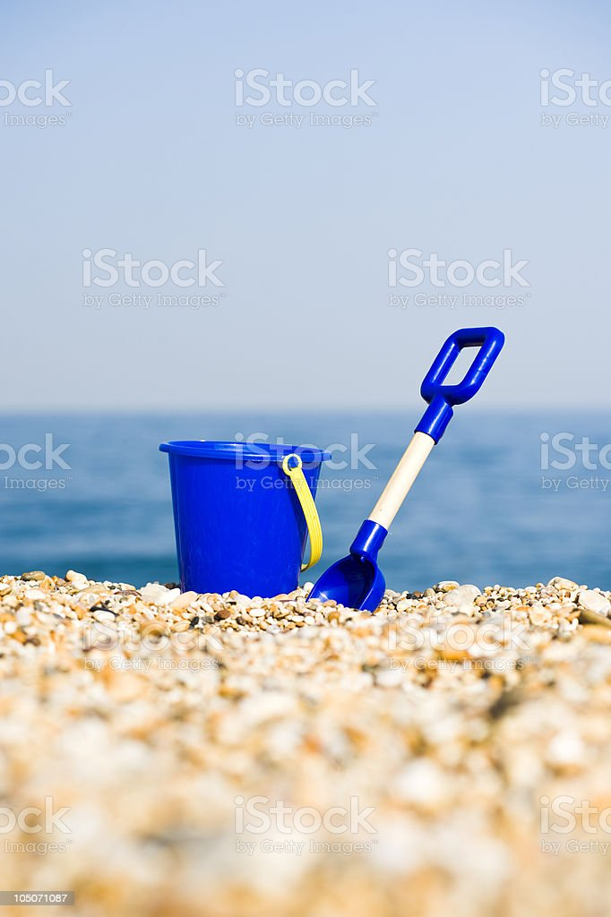 Blue Bucket And Spade At The Beach stock photo
