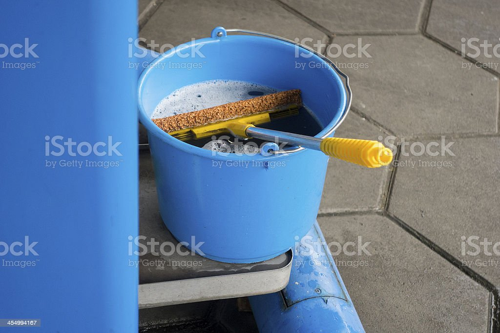 blue bucket and wipe at gas station stock photo