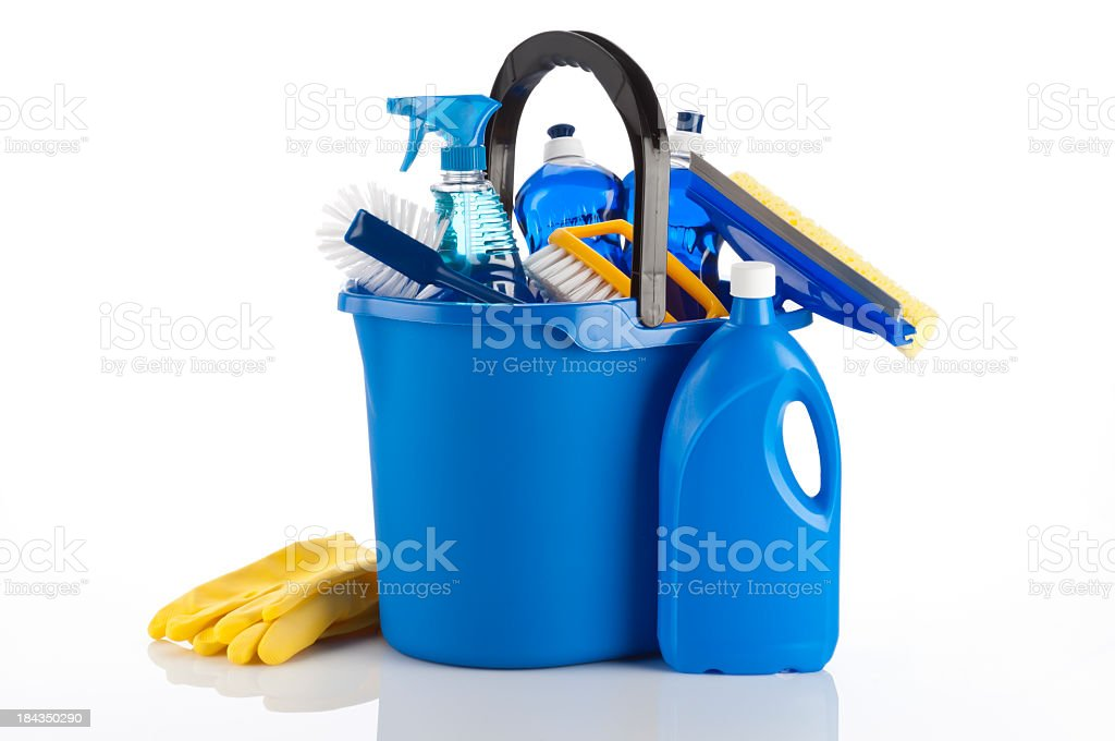 A blue bucket containing cleaning items and yellow gloves stock photo