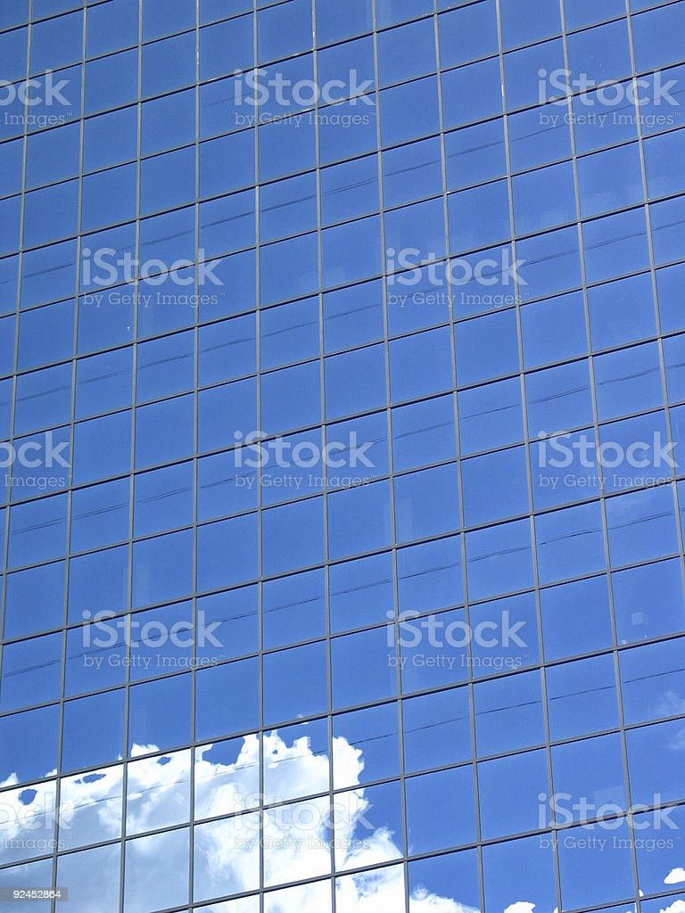 Blue Building with Cloud stock photo
