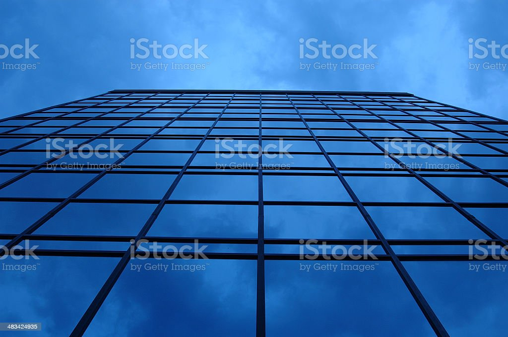 blue bulding extends to the sky stock photo