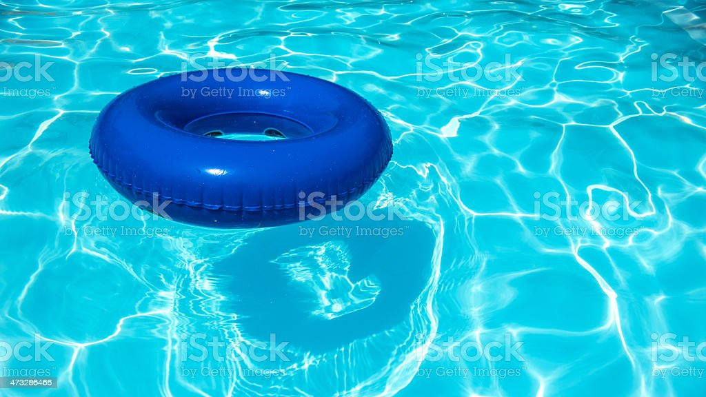 Blue Buoy on swimming pool stock photo